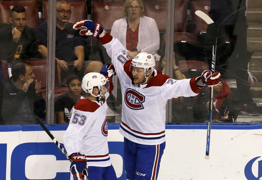 Montreal Canadiens left wing Nicolas Deslauriers (20) celebrates his first-period goal with Victor Mete (53) during an NHL hockey game against the Flo...
