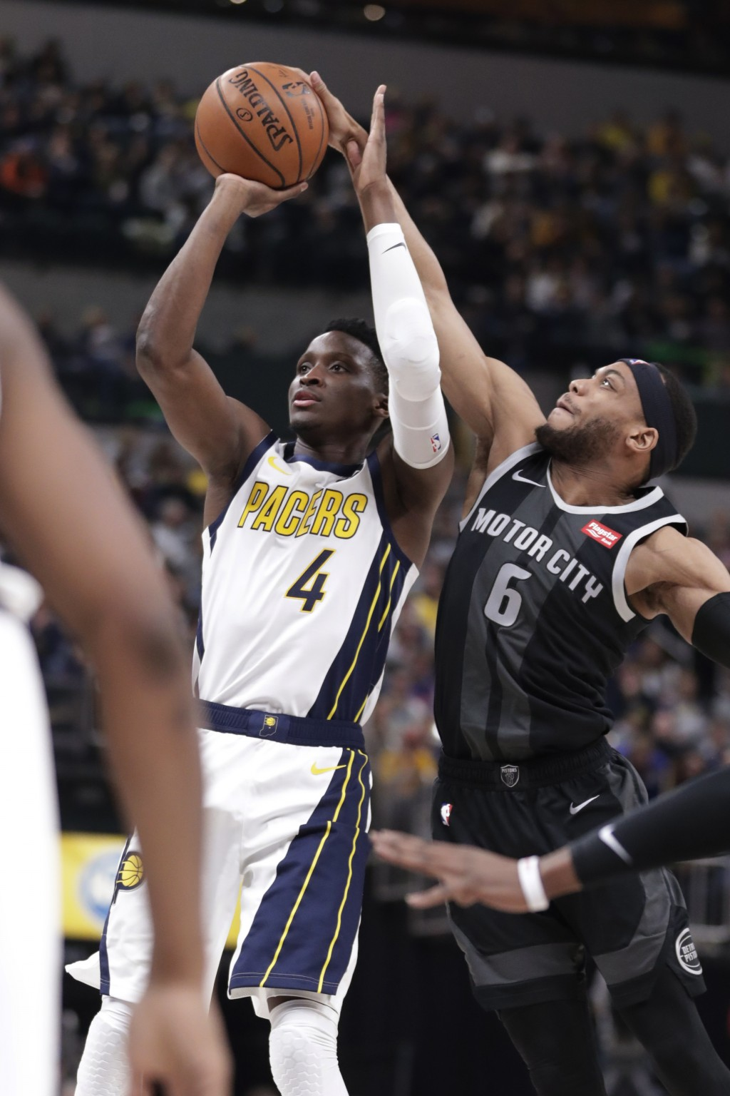 Indiana Pacers guard Victor Oladipo (4) is fouled by Detroit Pistons guard Bruce Brown (6) during the second half of an NBA basketball game in Indiana...