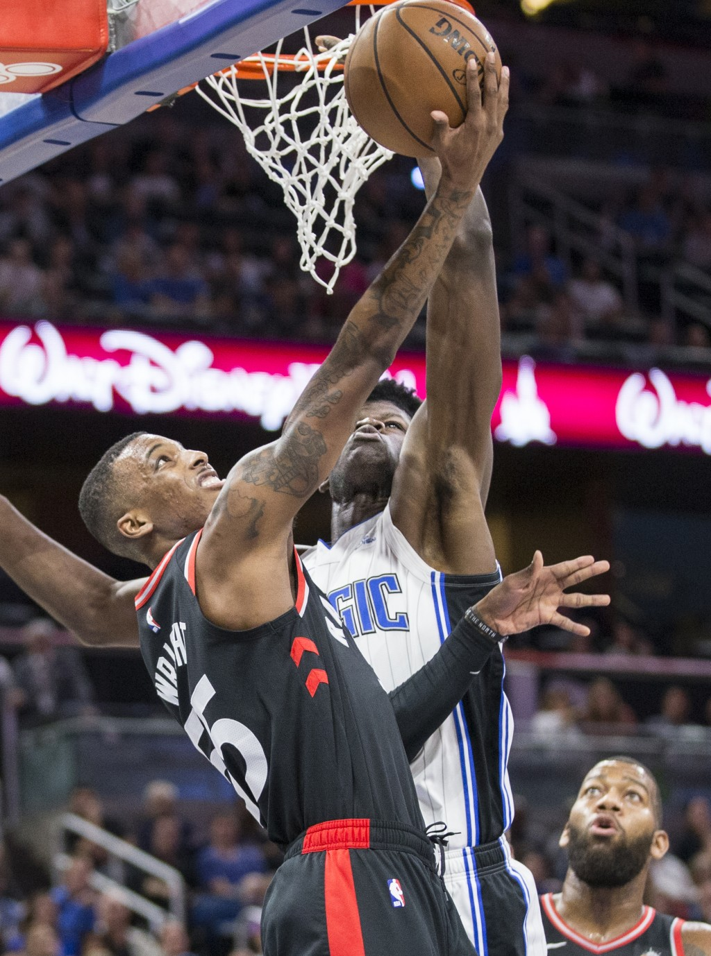 Toronto Raptors guard Delon Wright (55) takes the ball up against Orlando Magic center Mo Bamba (5) during the first half of an NBA basketball game in...