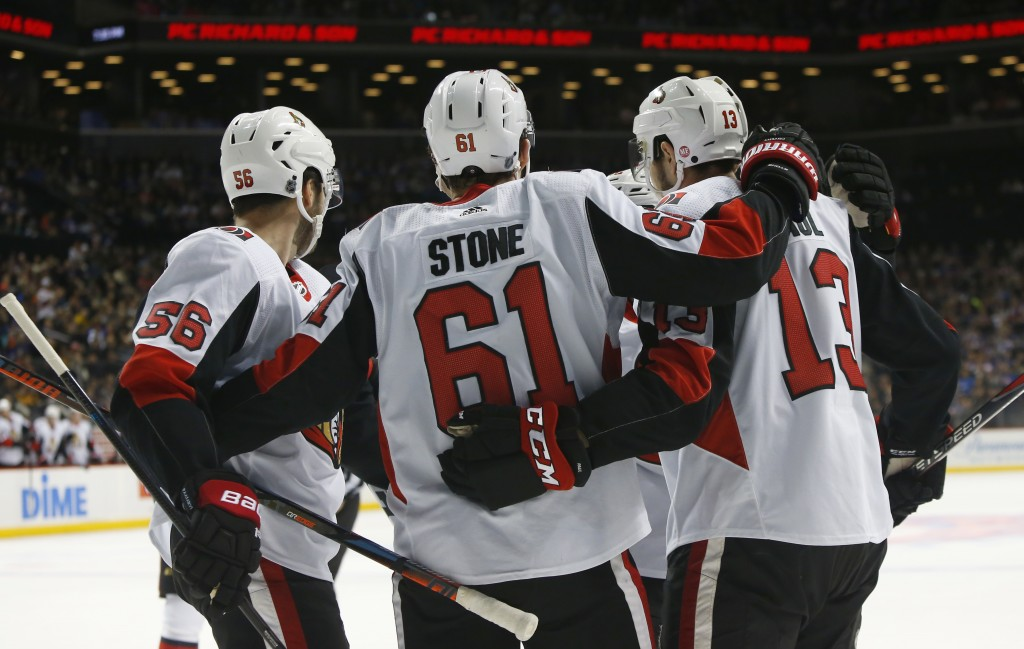 Ottawa Senators right wing Mark Stone (61) celebrates with teammates after scoring a goal against the New York Islanders during the first period of an...
