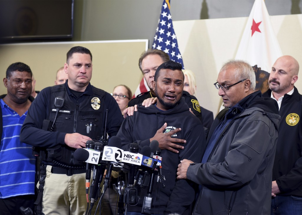 Reggie Singh, brother of Newman Police officer Ronil Singh is overcome with emotion as he thanks law enforcement after the arrest of suspect Gustavo P...