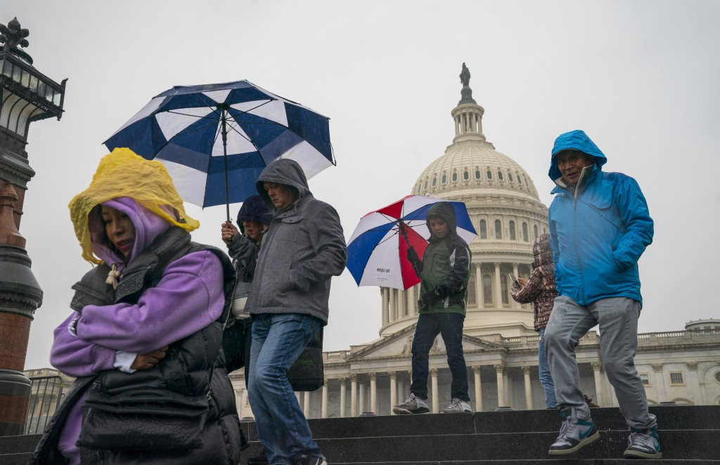 Tourists arrive to visit the U.S. Capitol on a rainy morning in Washington, Friday, Dec. 28, 2018, during a partial government shutdown. The partial g...