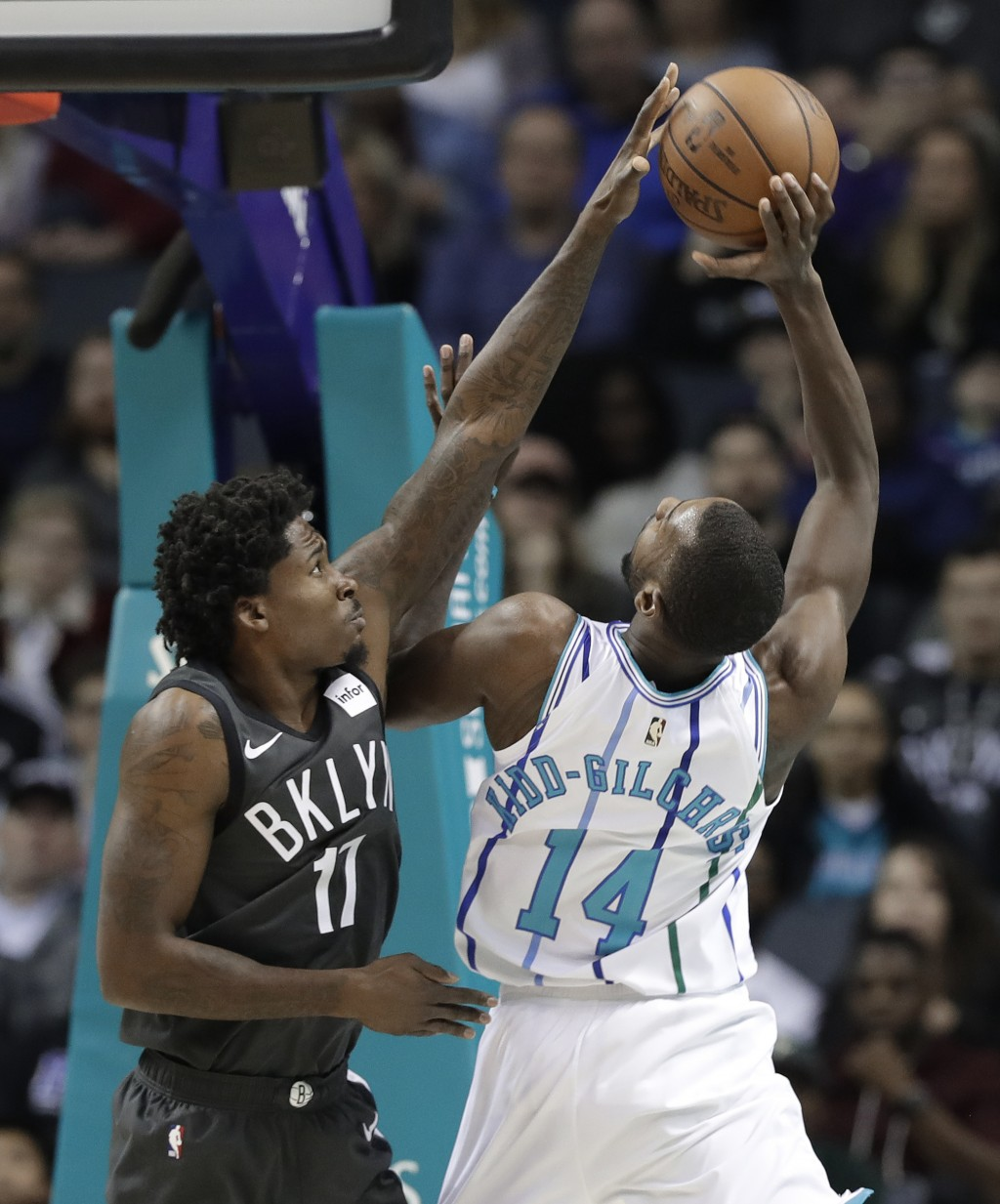 Brooklyn Nets' Ed Davis (17) blocks a shot by Charlotte Hornets' Michael Kidd-Gilchrist (14) during the first half of an NBA basketball game in Charlo...