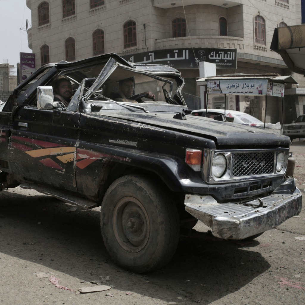 A man drives a damaged vehicle on a street in Ibb, Yemen, on Aug. 3, 2018. (AP Photo/Nariman El-Mofty)