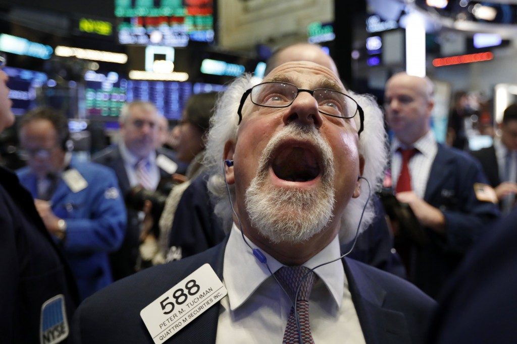 Trader Peter Tuchman works on the floor of the New York Stock Exchange, Friday, Dec. 28, 2018. Stocks are opening higher Friday as U.S. markets try to...