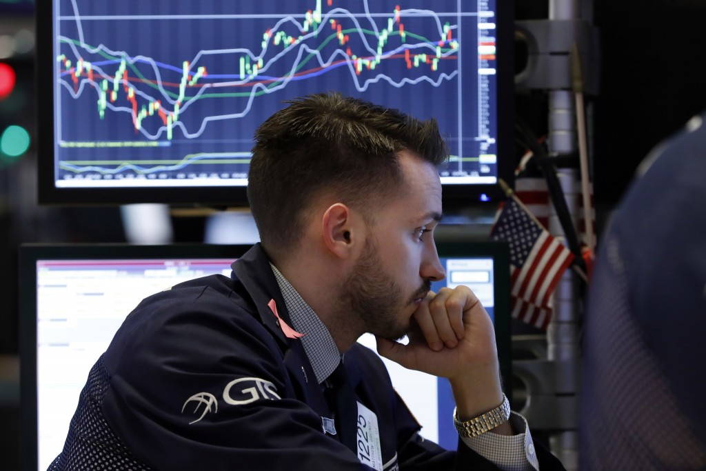 Specialist Matthew Greiner works at his post on the floor of the New York Stock Exchange, Friday, Dec. 28, 2018. U.S. stocks wavered between small gai