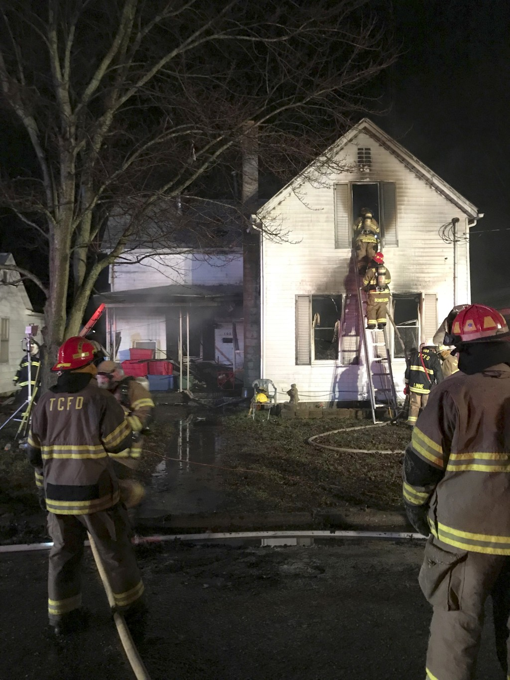 In this photo provided by the Indiana Department of Homeland Security, firefighters work to extinguish a deadly fire on Friday, Dec. 28, 2018, in Tell...