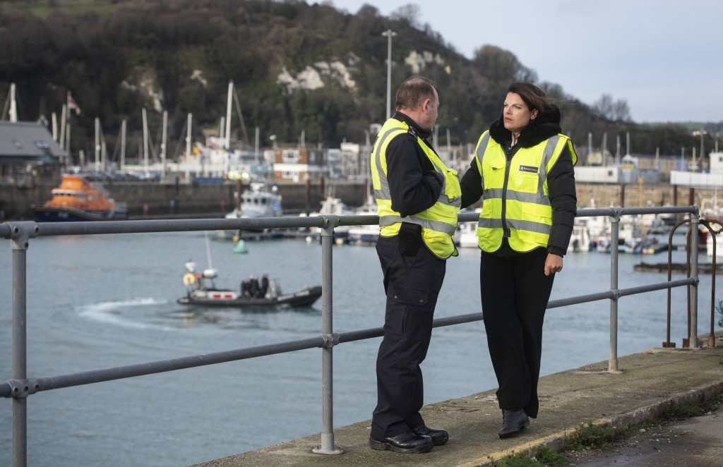 Britain's Immigration Minister Caroline Nokes talks to a Border Force officer as a Border Force RIB passes in the harbour, in Dover, England, to discu...
