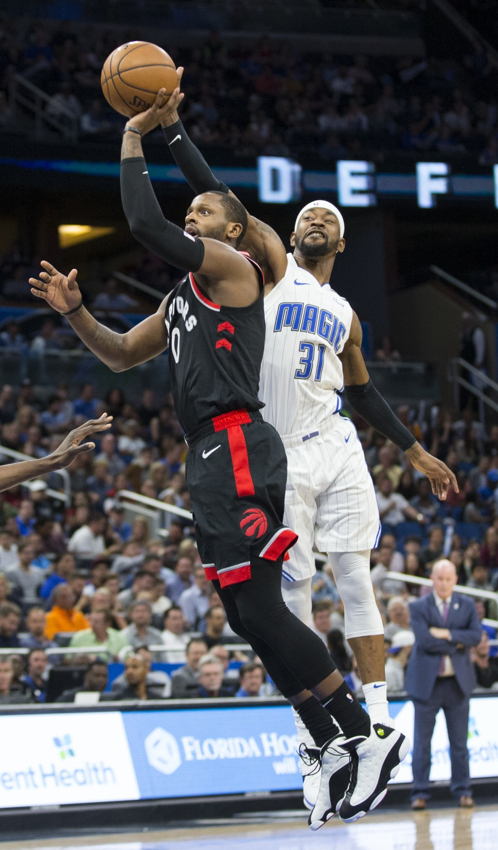 Toronto Raptors forward CJ Miles (0) shoots while Orlando Magic guard Terrence Ross (31) tries to block the shot during the first half of an NBA baske...