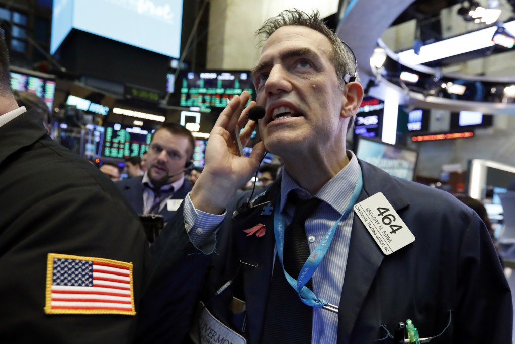 Trader Gregory Rowe works on the floor of the New York Stock Exchange, Friday, Dec. 28, 2018. Stocks are opening higher Friday as U.S. markets try to ...