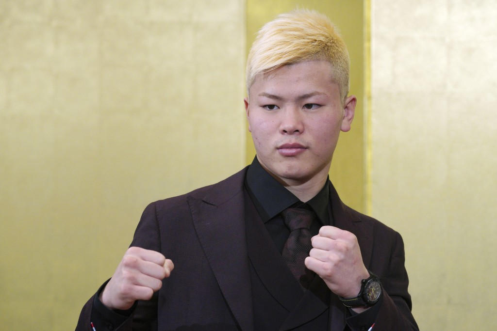 Japanese kickboxer Tenshin Nasukawa poses for media during a news conference in Tokyo Saturday, Dec. 29, 2018. Nasukawa is scheduled to fight Floyd Ma...