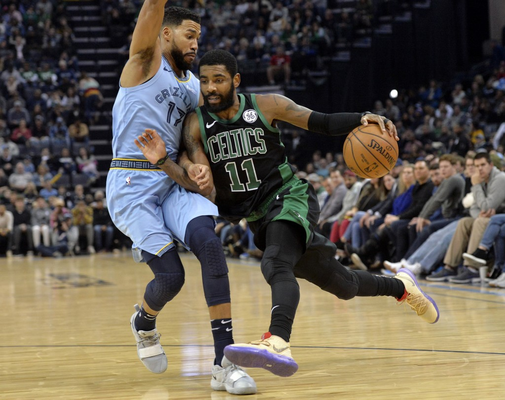 Boston Celtics guard Kyrie Irving (11) drives against Memphis Grizzlies guard Garrett Temple (17) during the second half of an NBA basketball game Sat...
