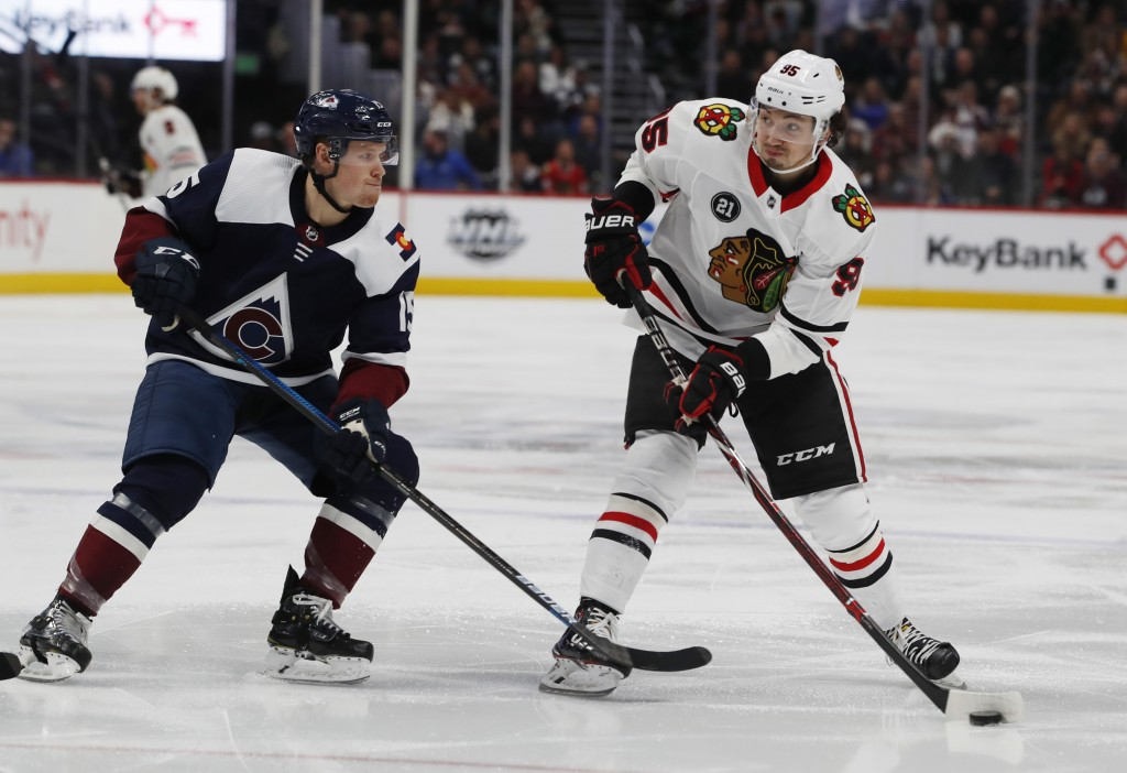 Chicago Blackhawks right wing Dylan Sikura, right, fires the puck at the net past Colorado Avalanche center Sheldon Dries in the second period of an N...