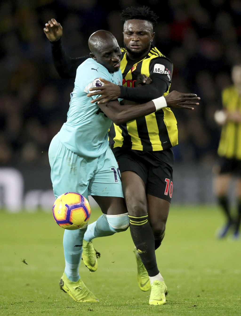 Newcastle United's Mohamed Diame, left, chases after the ball with Watford's Isaac Success, during their English Premier League soccer match, at Vicar...