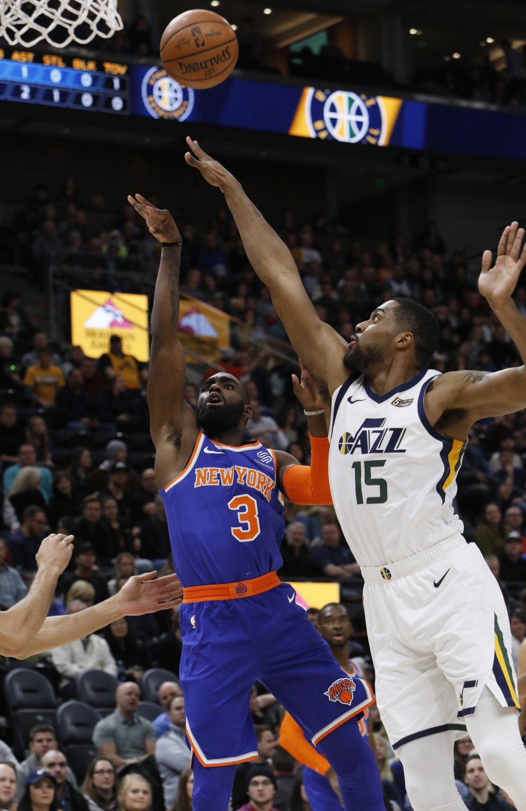 New York Knicks' Tim Hardaway Jr. (3) drives to the basket as Utah Jazz's Derrick Favors (15) defends in the first half of an NBA basketball game on S...