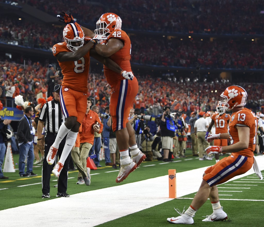 Clemson wide receiver Justyn Ross (8), defensive lineman Christian Wilkins (42) and wide receiver Hunter Renfrow (13) celebrates touchdown scored by R...