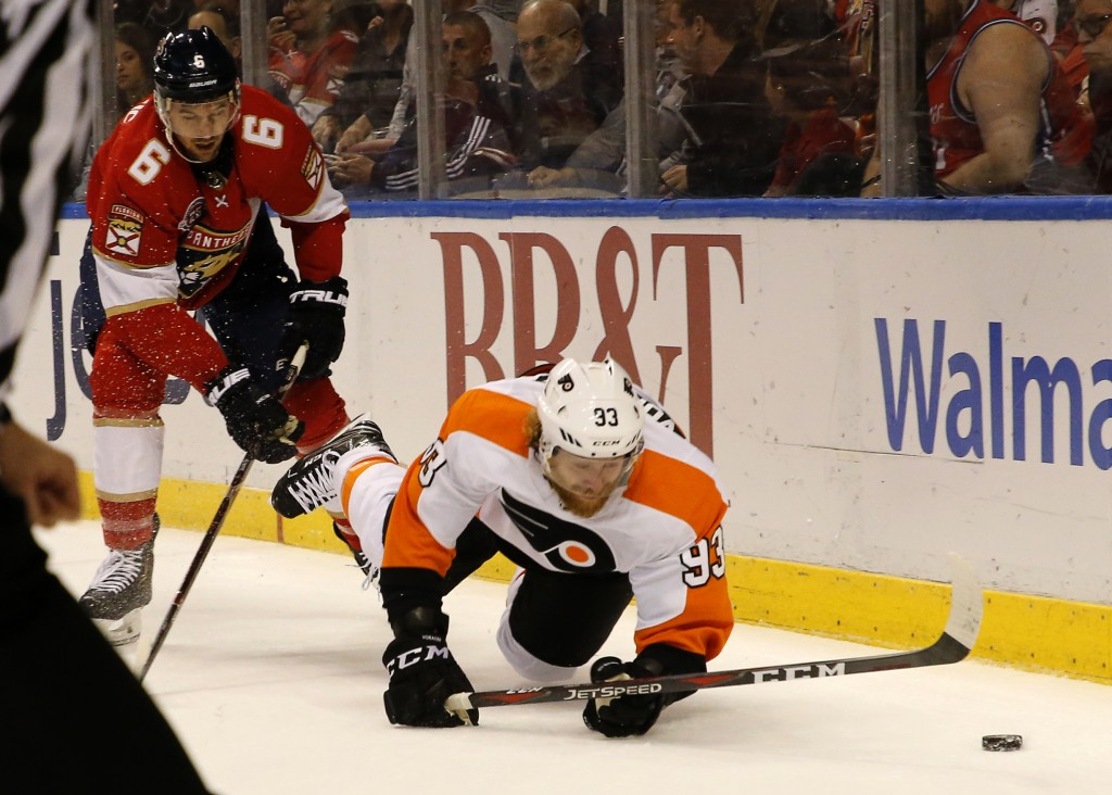 Philadelphia Flyers right wing Jakub Voracek (93) goes to the ice as Philadelphia Flyers defenseman Travis Sanheim (6) pursues in the first period of ...