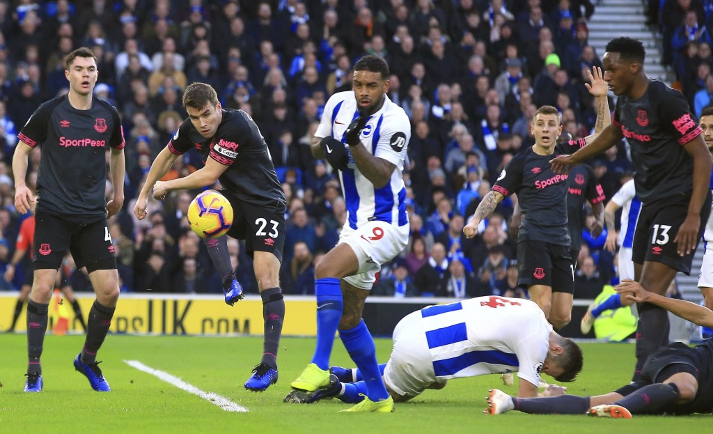 Everton's Seamus Coleman, second left, clears the ball during the game against Brighton & Hove Albion, during their English Premier League soccer matc...