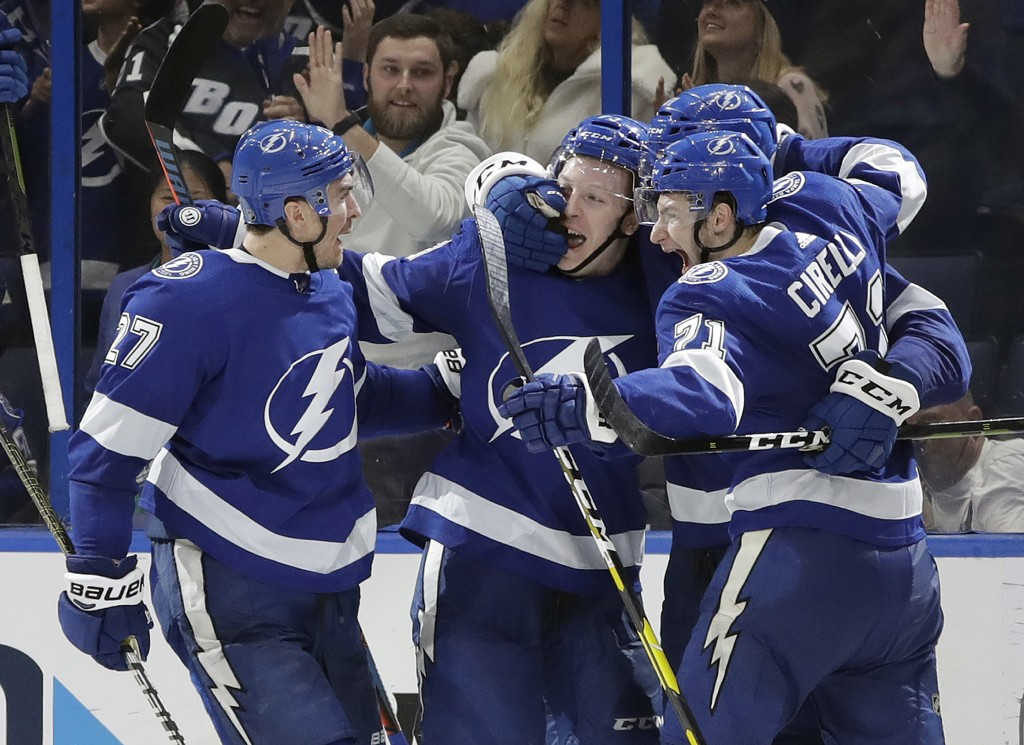 Tampa Bay Lightning left wing Adam Erne, second from left, celebrates his goal against the Montreal Canadiens with defenseman Ryan McDonagh, left, and...
