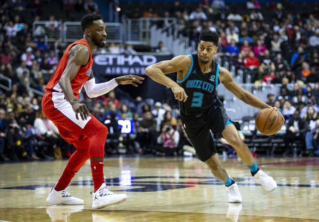 Charlotte Hornets guard Jeremy Lamb (3) drives against Washington Wizards forward Jeff Green during the first half of an NBA basketball game Saturday,...