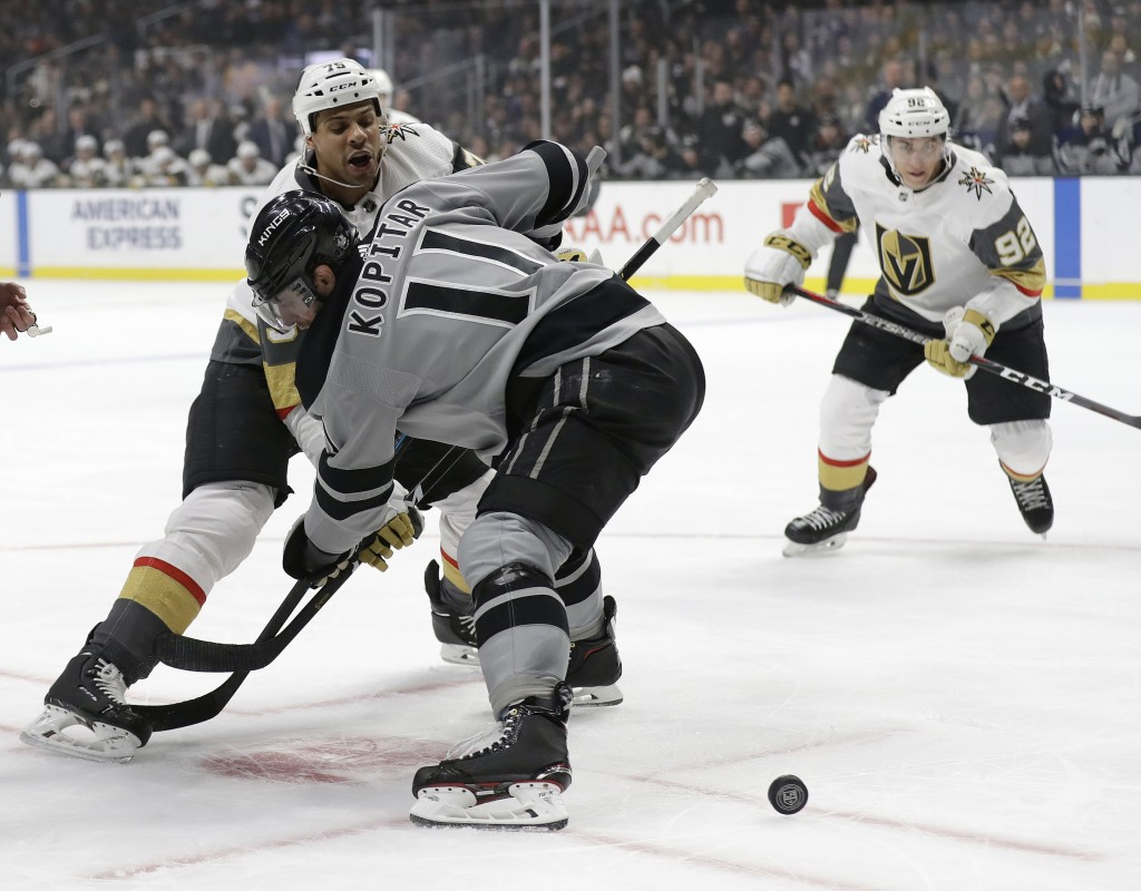 Vegas Golden Knights' Ryan Reaves, left, faces off against Los Angeles Kings' Anze Kopitar during the first period of an NHL hockey game Saturday, Dec...