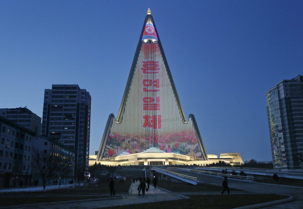 In this Dec. 20, 2018, photo, a propaganda message is displayed on the facade of the pyramid-shaped Ryugyong Hotel in Pyongyang, North Korea. Transfor...