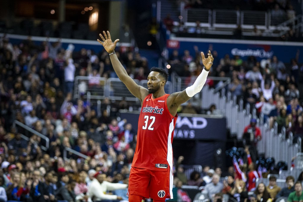 Washington Wizards forward Jeff Green (32) celebrates during the second half of an NBA basketball game against the Charlotte Hornets, Saturday, Dec. 2...