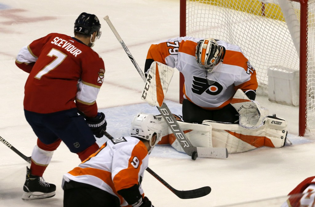 Philadelphia Flyers goaltender Carter Hart (79) makes a save in front of Florida Panthers center Colton Sceviour (7) in the second period of an NHL ho...