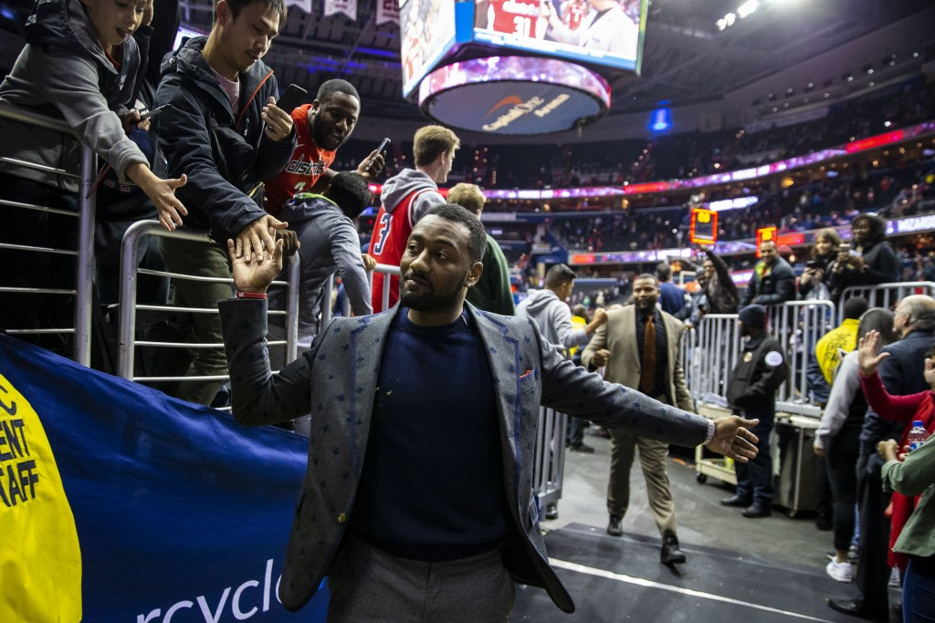 Washington Wizards guard John Wall leaves the court following the team's NBA basketball game against the Charlotte Hornets, Saturday, Dec. 29, 2018, i...