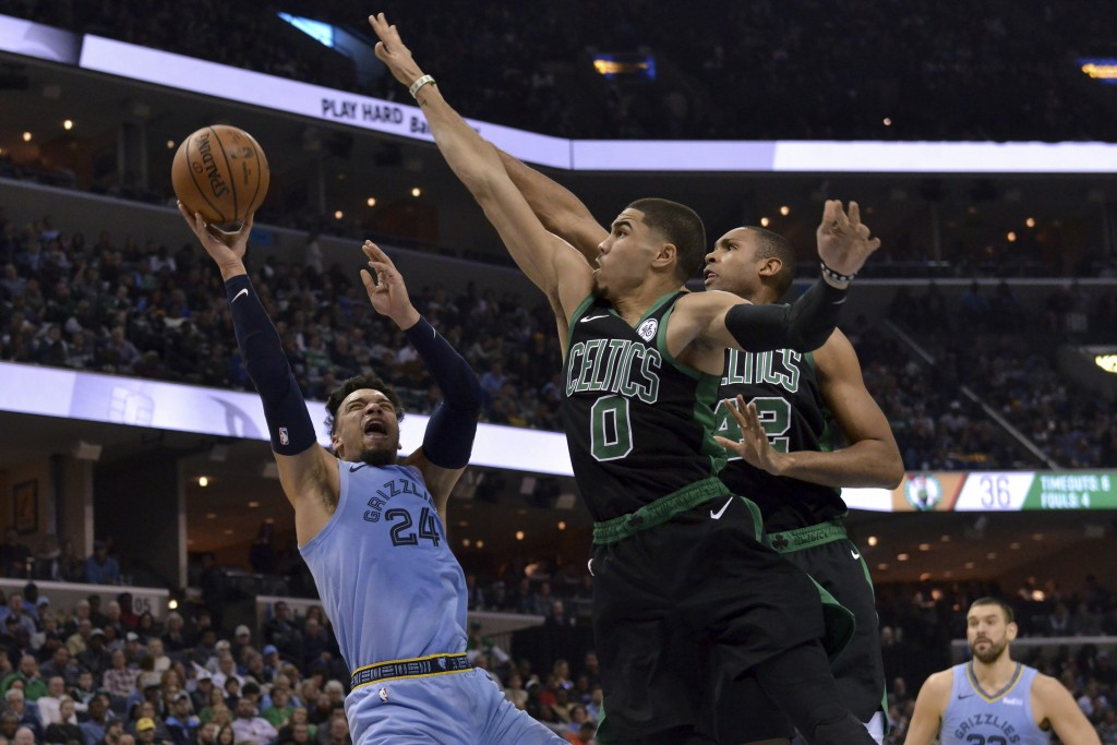 Memphis Grizzlies guard Dillon Brooks (24) shoots against Boston Celtics forward Jayson Tatum (0) and center Al Horford (42) during the first half of ...