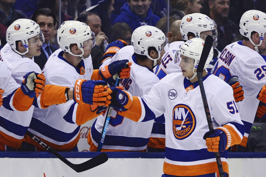 New York Islanders centre Valtteri Filppula (51) celebrates his goal against the Toronto Maple Leafs during first period NHL hockey action in Toronto ...