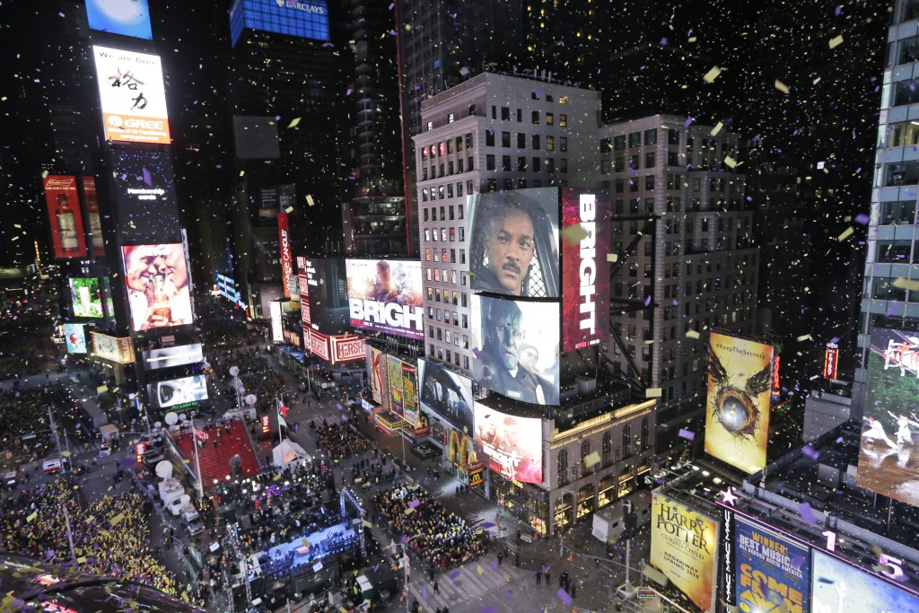 FILE - In this Jan. 1, 2018, file photo, confetti flies over Times Square during the New Year's celebration in New York. The New York Police Departmen...