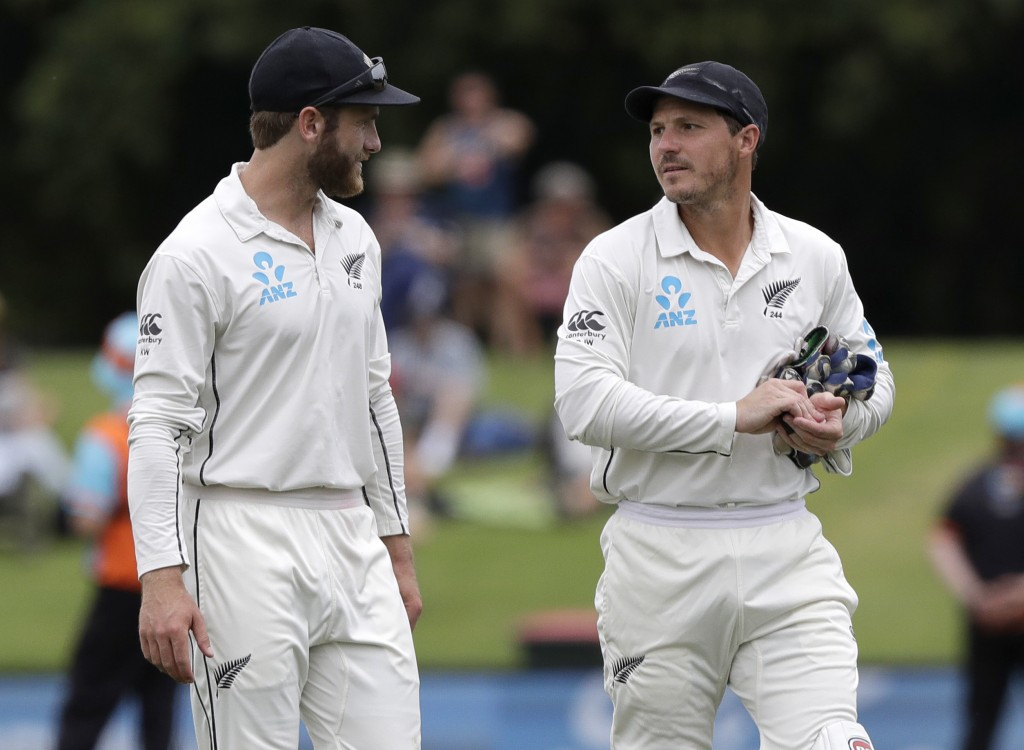 New Zealand captain Kane Williamson, left, walks from the field with teammate BJ Watling following their 423 run win over Sri Lanka on the final day o...