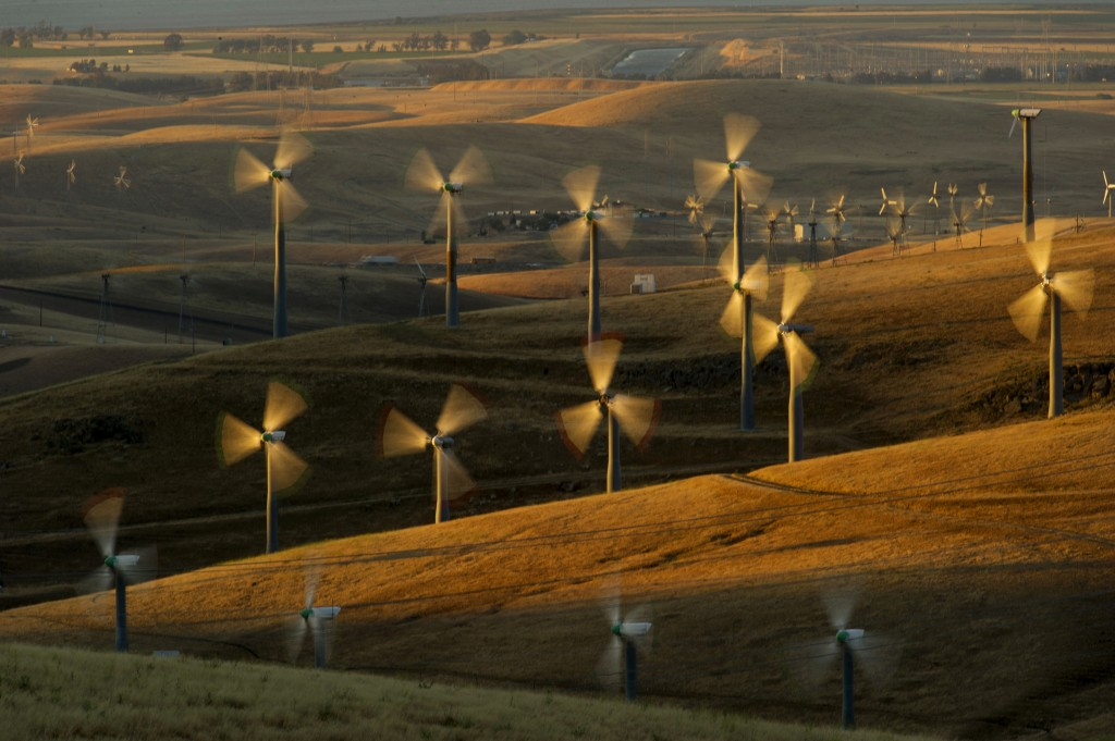 FILE - In this May 12, 2013, file photo, wind turbines lining the Altamont Pass near Livermore, Calif., generate electricity. California's utilities m...