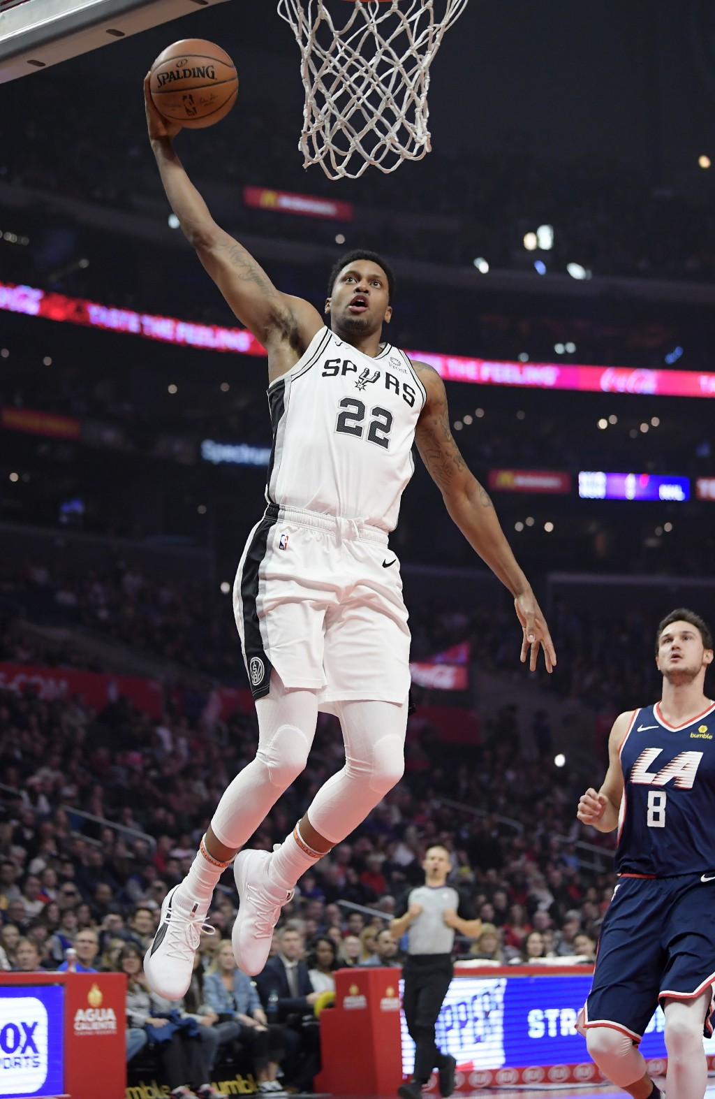 San Antonio Spurs forward Rudy Gay goes up for a dunk as Los Angeles Clippers forward Danilo Gallinari watches during the first half of an NBA basketb...