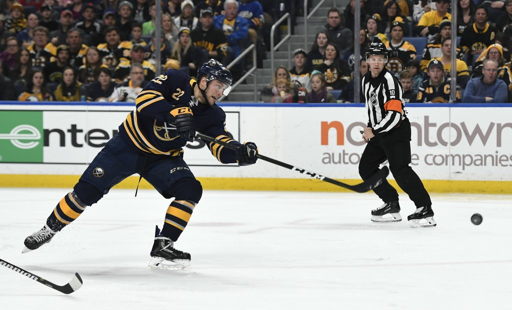 Buffalo Sabres center Johan Larsson (22) scores a short-handed goal past Boston Bruins goalie Tuukka Rask (40) during the second period of an NHL hock...