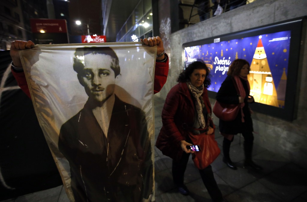 A man from opponents group shows picture of Gavrilo Princip, the Bosnian-Serb nationalist who assassinated Archduke Franz Ferdinand in 1914, during a ...