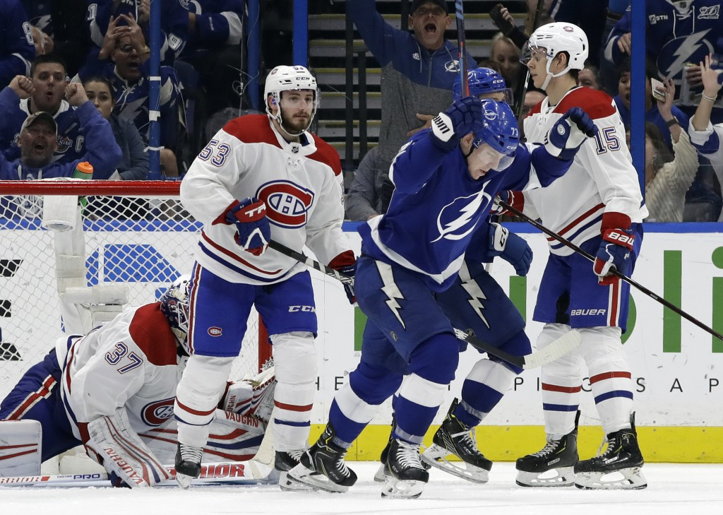 Tampa Bay Lightning left wing Adam Erne (73) celebrates in front of Montreal Canadiens defenseman Victor Mete (53) and center Jesperi Kotkaniemi (15) ...