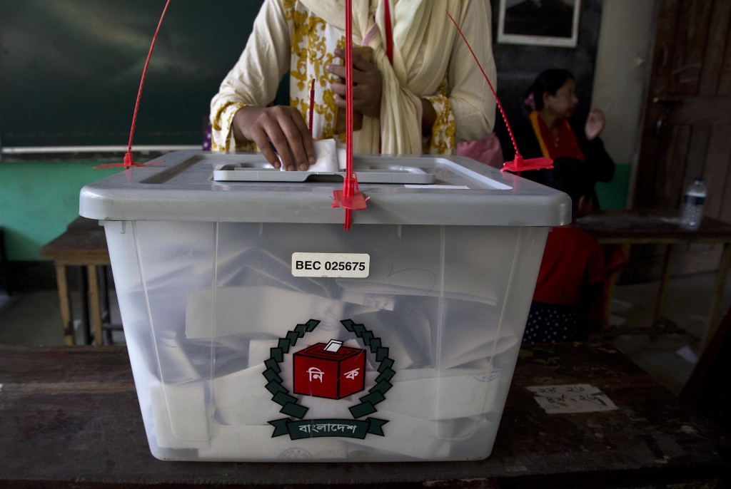 A Bangladeshi woman casts her vote at a polling station in the ancient city of Panam Nagar, about 20 kilometers (12 miles) southeast of Dhaka, Banglad...