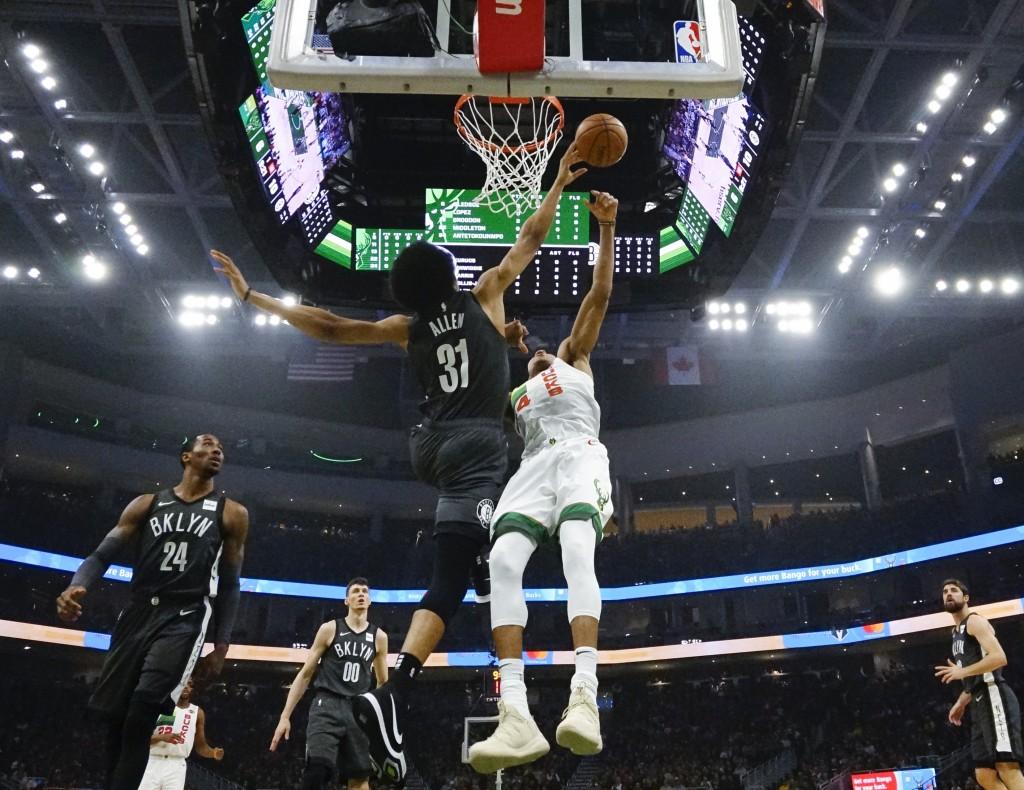Brooklyn Nets' Jarrett Allen blocks a shot by Milwaukee Bucks' Giannis Antetokounmpo during the first half of an NBA basketball game Saturday, Dec. 29...