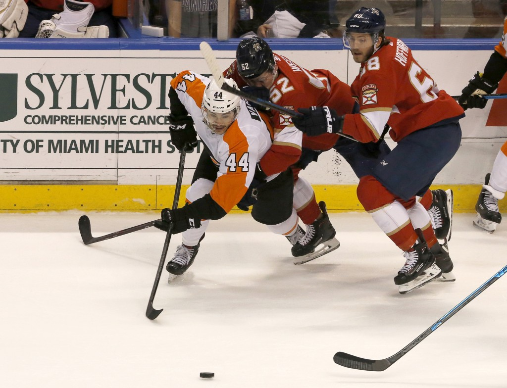 Philadelphia Flyers center Phil Varone skates to the puck as Florida Panthers defenseman MacKenzie Weegar (52) and left wing Mike Hoffman (68) pursue ...