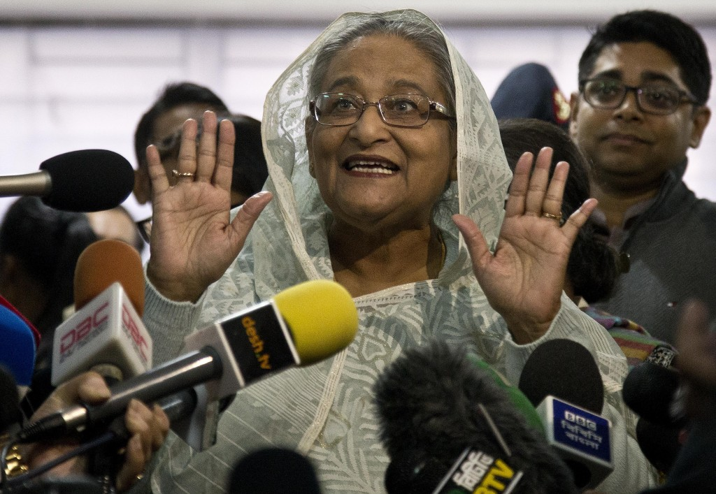 Bangladesh Prime Minister Sheikh Hasina speaks to the media persons after casting her vote in Dhaka, Bangladesh, Sunday, Dec. 30, 2018. Voting began S...