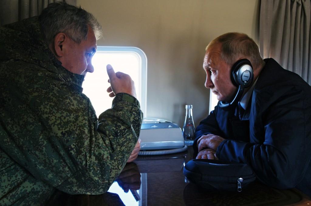 FILE In this file photo taken on Thursday, Sept. 13, 2018, Russian President Vladimir Putin, right, listens to Russian Defense Minister Sergei Shoigu ...