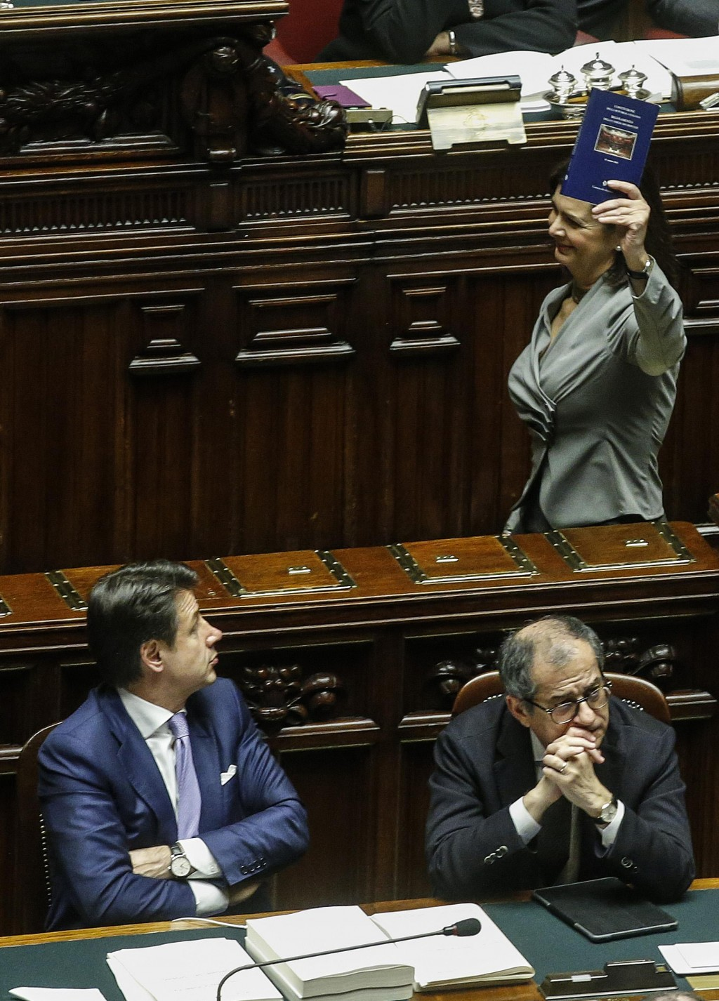 Former lower chamber President Laura Boldrini, top right, shows the Constitution to Italian Premier Giuseppe Conte, left, and Economy Minister Giovann...