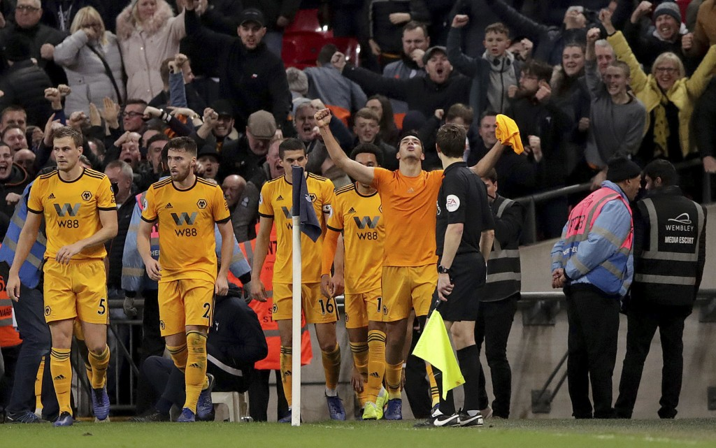 Wolverhampton Wanderers' Raul Jimenez, centre, celebrates scoring his side's second goal of the game against Tottenham Hotspur during their English Pr...