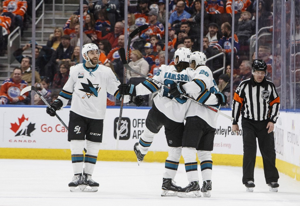 San Jose Sharks' Barclay Goodrow (23), Erik Karlsson (65) and Marcus Sorensen (20) celebrate a goal against the Edmonton Oilers during the second peri...