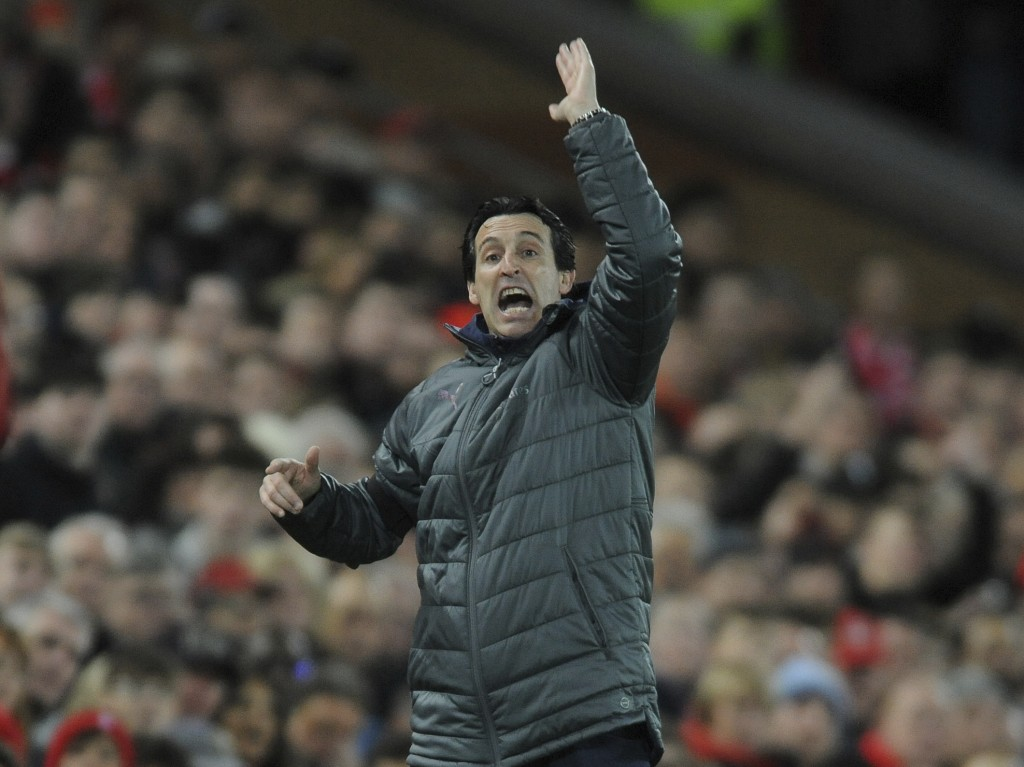 Arsenal's manager Unai Emery gestures to his players during the English Premier League soccer match between Liverpool and Arsenal at Anfield in Liverp...