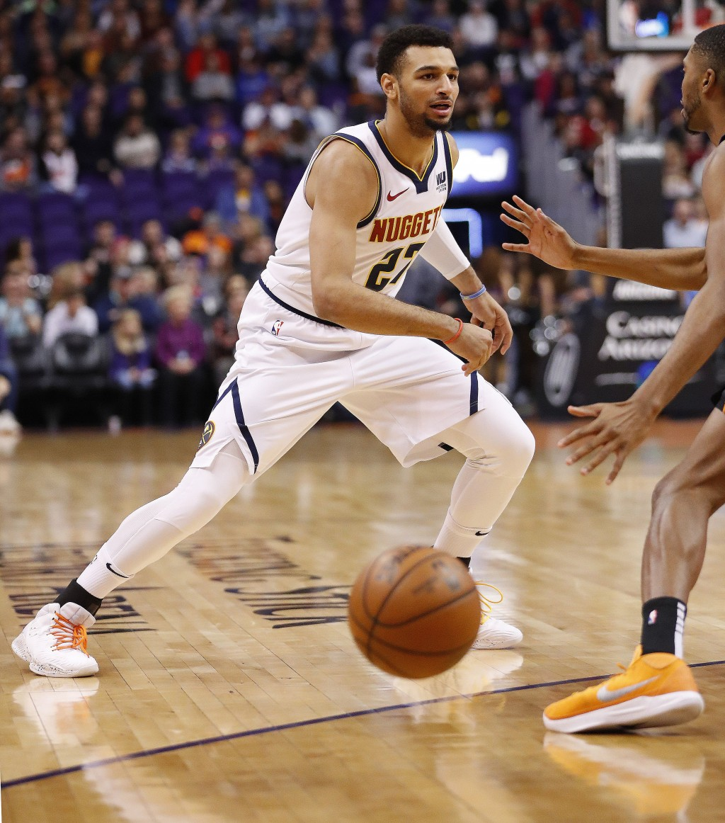 Denver Nuggets guard Jamal Murray (27) passes against the Phoenix Suns during the first half of an NBA basketball game, Saturday, Dec. 29, 2018, in Ph...