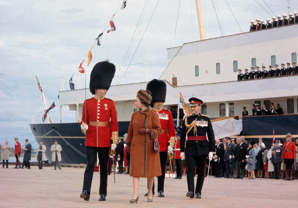 FILE - In this file photo dated Oct. 6, 1964, Britain's Queen Elizabeth II is escorted by Captain G. L. Simpson, as she leaves the Royal Yacht Britann...