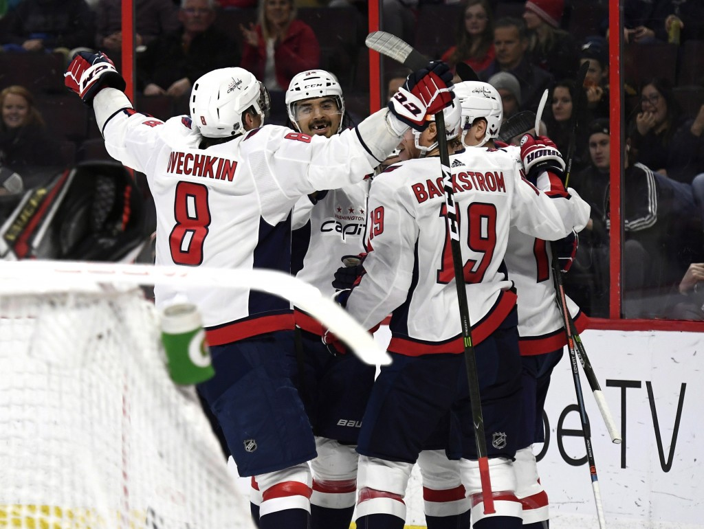 Washington Capitals players celebrate a goal against the Ottawa Senators during the first period of an NHL hockey game, Saturday, Dec. 29, 2018 in Ott...
